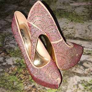 Pink and gold studded heels